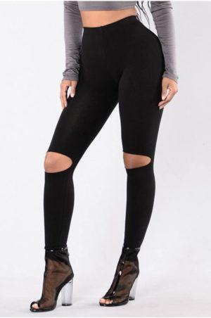 Snygga svarta leggings med hål för knäna.