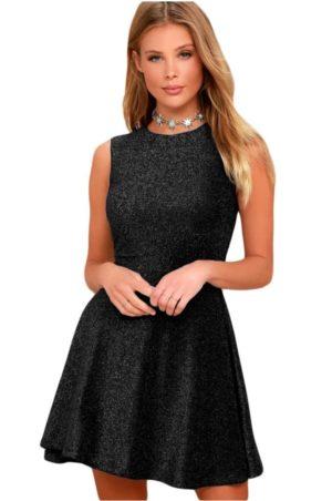Snygg svart klänning med silverglitter effekt.